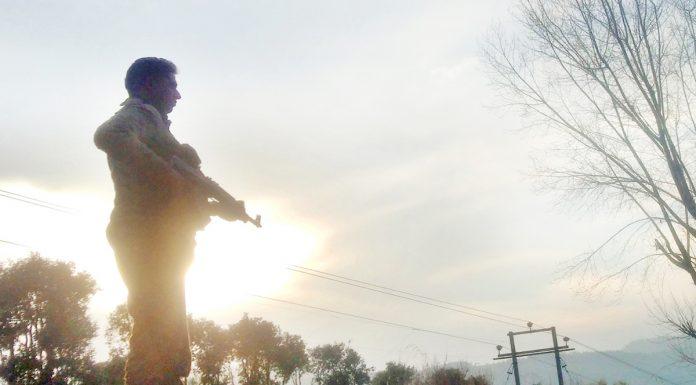 Jawan guards a border village at Balakote in Mendhar sector during Sunset. -Excelsior/Rahi Kapoor