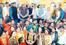 BJP senior leaders posing with youth who joined party at Jammu on Monday.