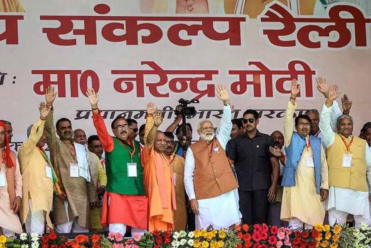 Prime Minister Narendra Modi, Uttar Pradesh Chief Minister Yogi Adityanath and other senior leaders during a rally, ahead of Lok Sabha 2019 elections, in Meerut on Thursday.