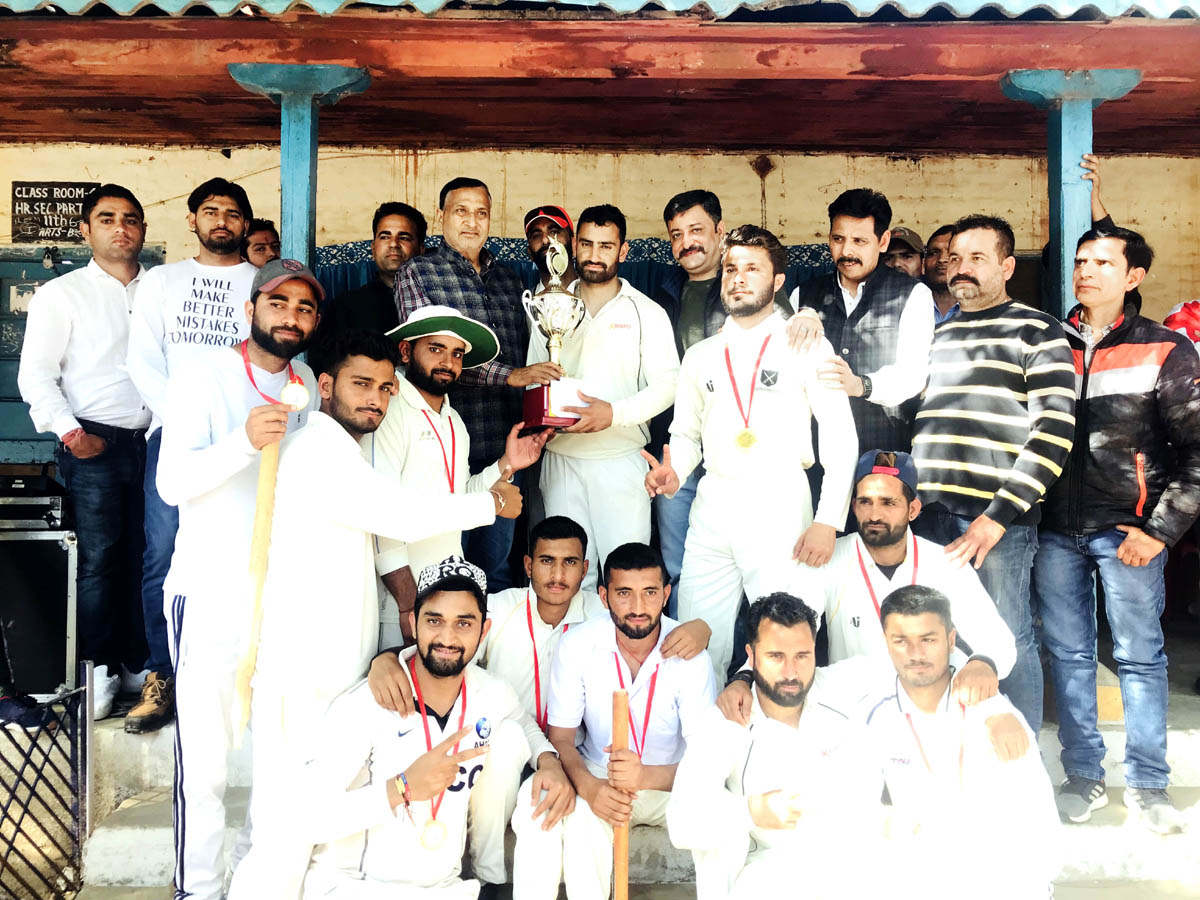 Winners of New Year T20 Cup posing for a photograph after receiving trophy from former Minister Sham Lal Sharma at Akhnoor.