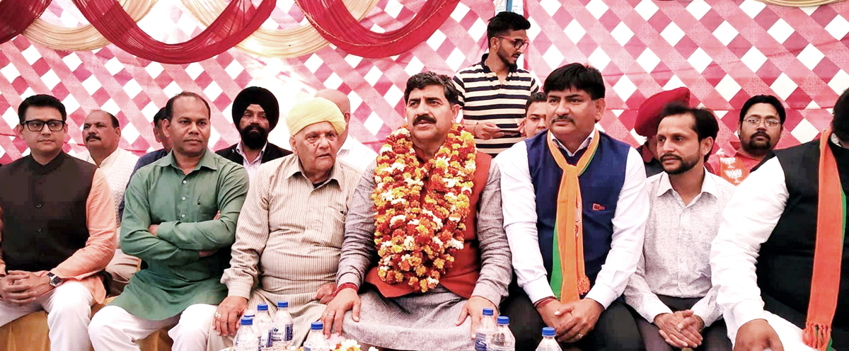 MP, Jugal Kishore Sharma & MLC, Ashok Khajuria during an election meeting at R S Pura on Monday.