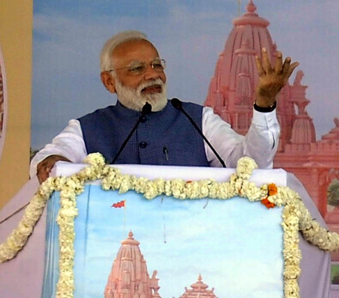 Prime Minister Narendra Modi addressing the foundation stone laying ceremony of Shikshan Bhavan and Vidhyarthi Bhavan, at Adalaj in Gandhinagar on Tuesday. (UNI)