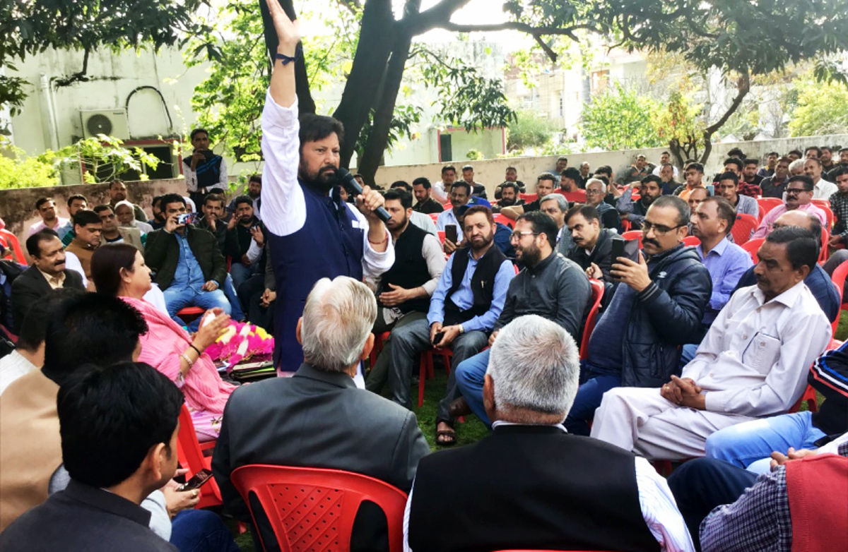 DSS president and former MP Ch Lal Singh addressing workers at Kathua on Saturday.