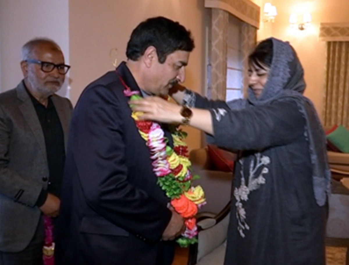 PDP president, Mehbooba Mufti felicitating new entrant into party fold at a function in Srinagar.