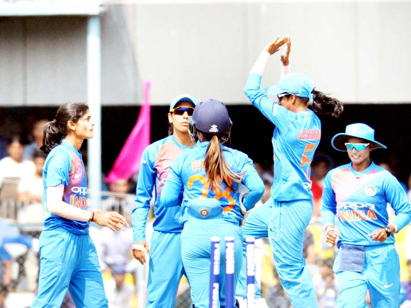 Indian women's cricket team celebrate the fall of an England wicket during the second International T20 cricket match in Guwahati on Thursday.