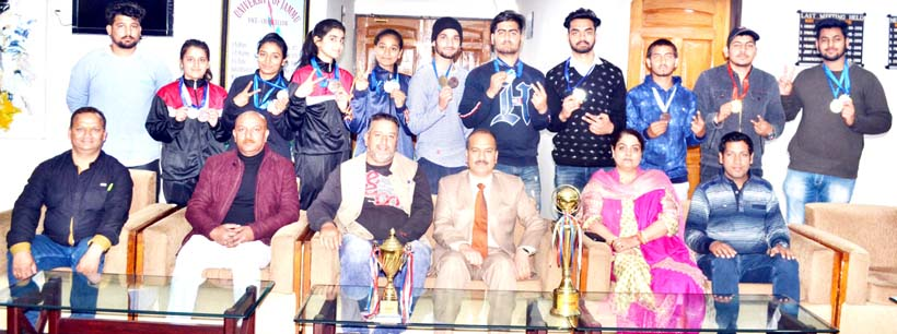 Grappling team posing along with VC Prof Manoj Dhar during felicitation function on Thursday.