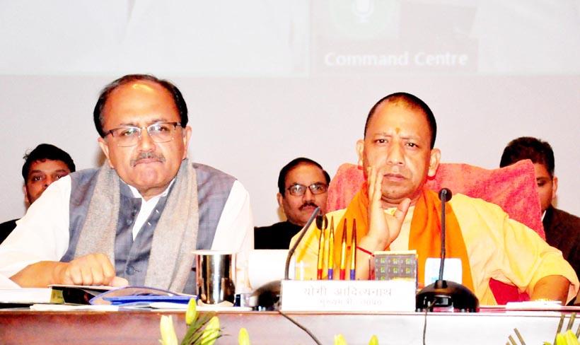 Uttar Pradesh Chief Minister Yogi Aditiyanath and Health Minister Sidharnath Singh during inauguration of several health schesms at Lok Bhawan in Lucknow on Friday. (UNI)