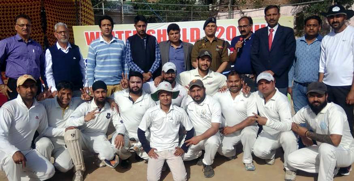 Winners of opening tie of Winter Shield T20 Cup posing along Commissioner Secretary YSS, Sarmad Hafeez and other dignitaries in Jammu on Friday.