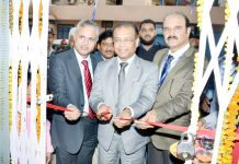 SBI GM Subhash Joinwal inaugurating new building of Bank at Nowshera on Monday.