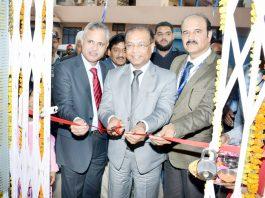 SBI GM Subhash Joinwal inaugurating new building of Bank at Nowshera on Monday.