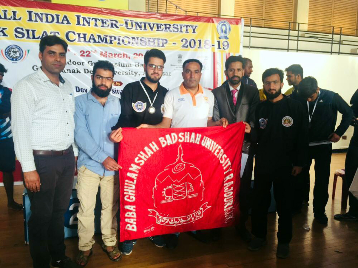 Peancak Silat team of Baba Ghulam Shah Badshah University Rajouri posing for a group photograph after winning bronze medal in Inter-University C'ship.