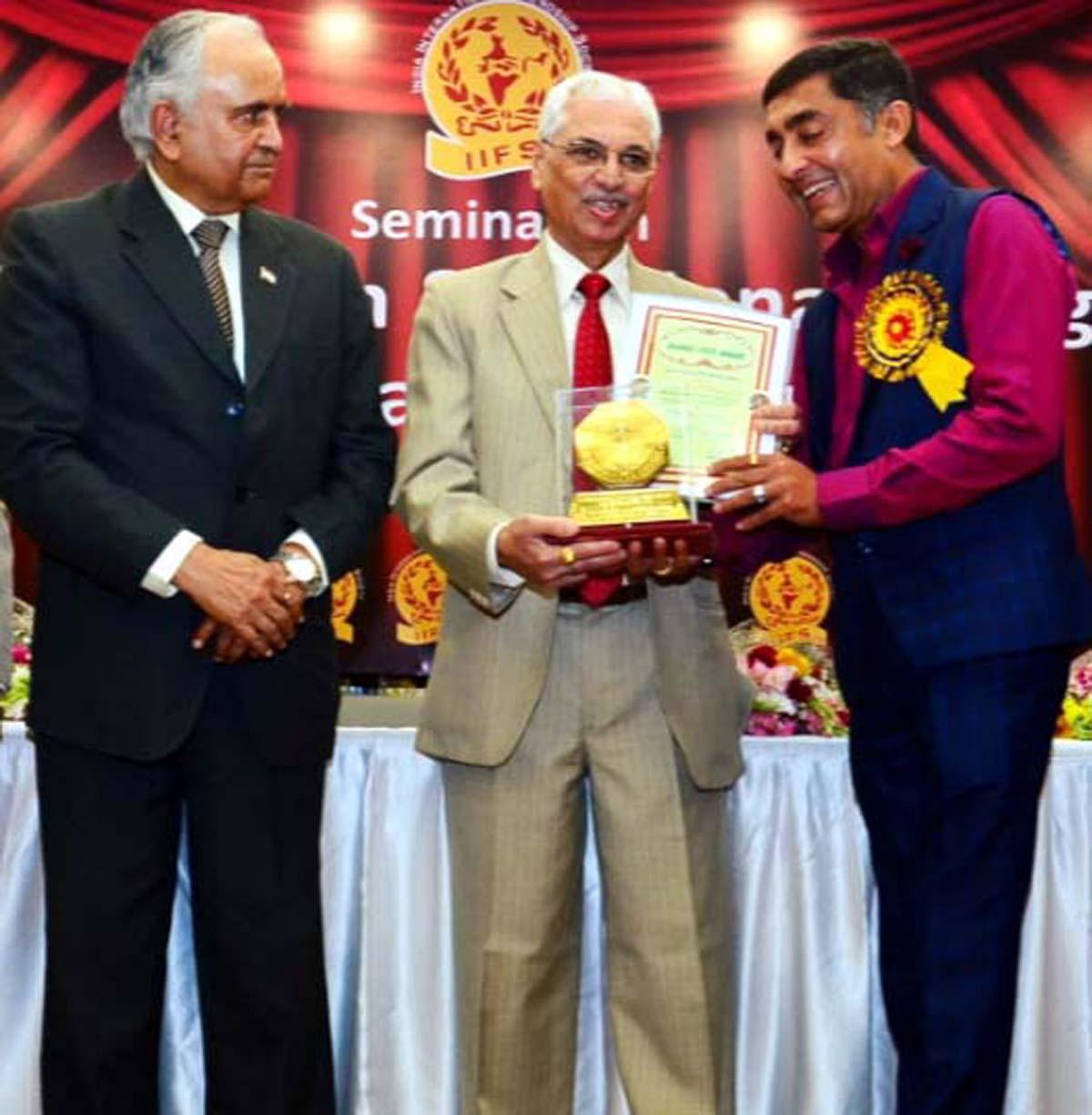 Suneel Mahajan, a noted social worker from Jammu receiving 'Bharat Jyoti Award' from a dignitary at New Delhi.