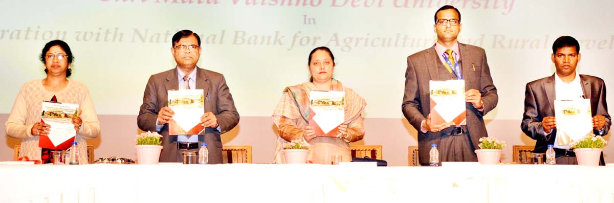 Sheetal Nanda and other guests releasing souvenir during inauguration of international seminar at SMVDU on Tuesday.