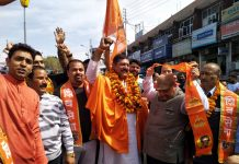 Shiv Sena leader Manish Sahni along with party leaders and his supporters during a rally at Jammu.
