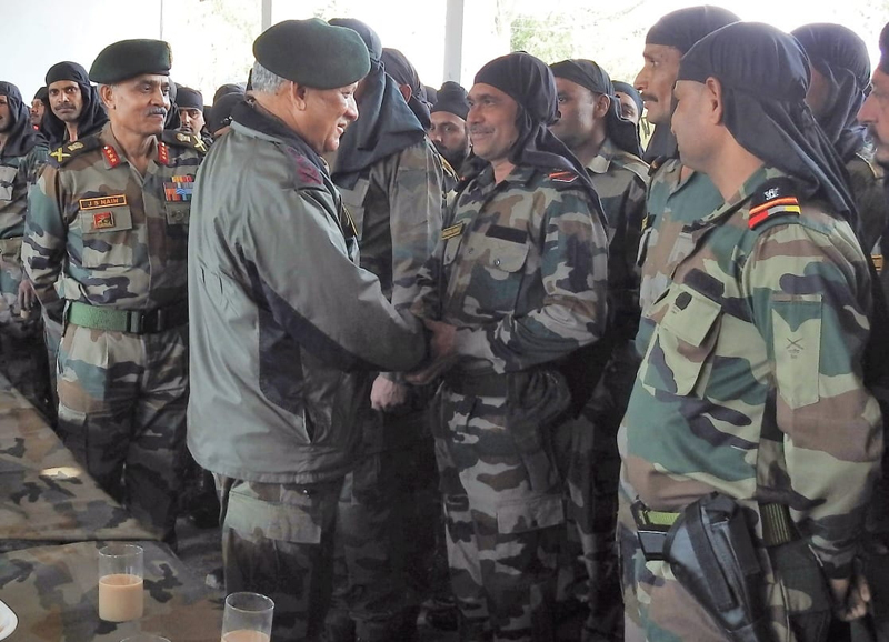 Army chief Gen Bipin Rawat interacting with soldiers in a forward area of Jammu on Sunday.