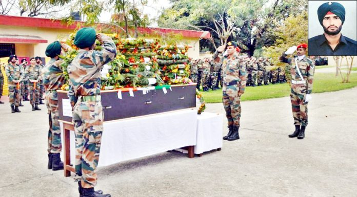 Army officials paying tributes to Karamjeet Singh on Monday.(Inset) Martyr soldier.