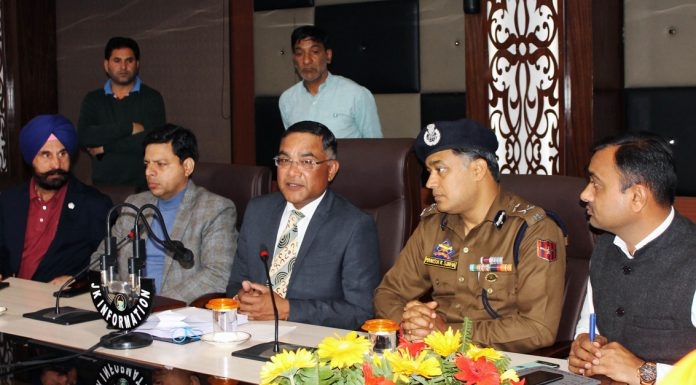 CEO Shailendra Kumar flanked by senior civil and police officers addressing a press conference in Jammu on Sunday. —Excelsior/Rakesh