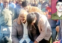 Wailing father of martyr Yash Paul (Inset) being consoled by the people.