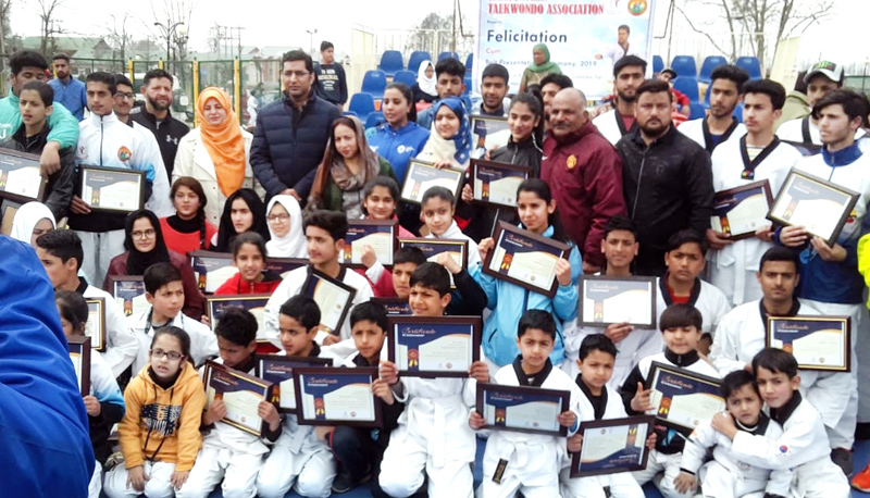 Taekwondo players posing for a photograph along with DC Srinagar, Dr Shahid Iqbal Choudhary on Sunday.