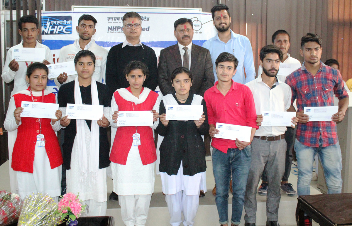 Students of Government Degree College Basohli after receiving scholarships on Tuesday.