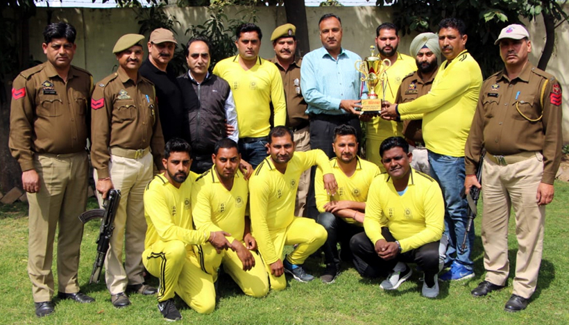 GRP Jammu team posing for a group photograph after winning 3rd Shaheed Bhagat Singh Memorial Cricket Tournament.