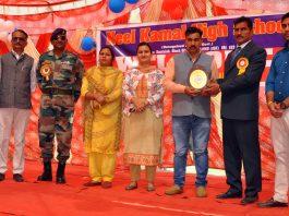 Memento presentation during Annual Day celebration at Neel Kamal School in Jammu.