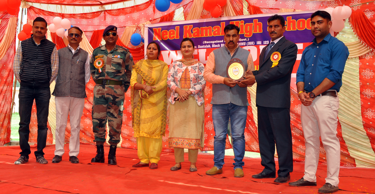 Memento presentation during Annual Day celebration at Neel Kamal School in Jammu.