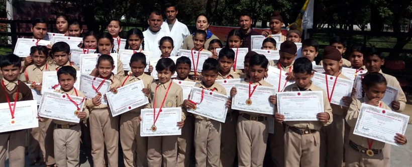 Children displaying certificates after qualifying Belt Grading Test in Jammu.