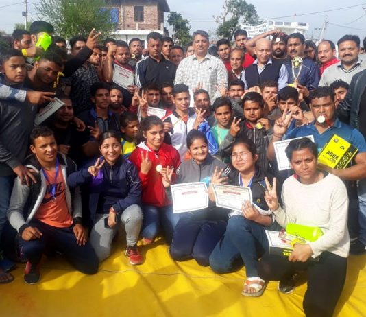 Wrestlers posing along with SSP Dushyant Sharma and other dignitaries in Jammu.