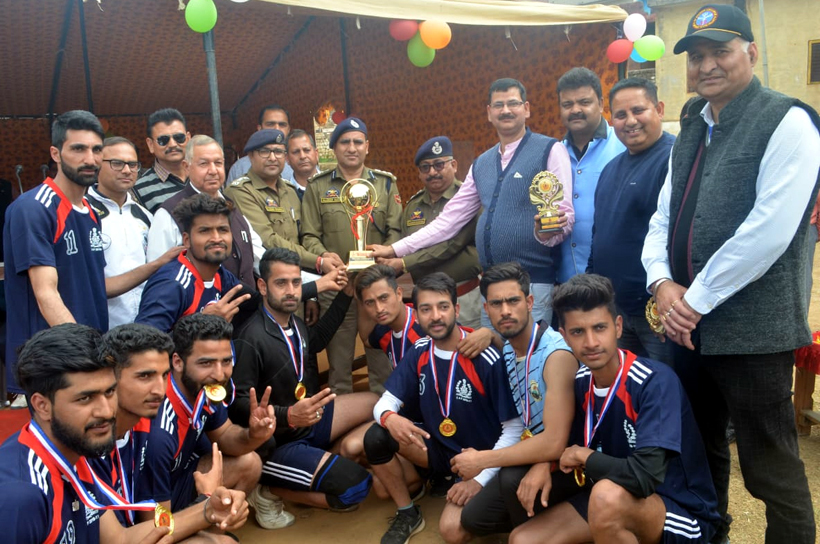 Winners posing for a group photograph along with dignitaries on the closing ceremony of Volleyball Tournament in Udhampur.