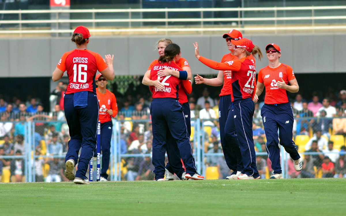 England players celebrating after dismissal of Harleen B Deol, during 1st T20 women cricket match against India at ACA Stadium, Barsapara in Guwahati on Monday. (UNI)