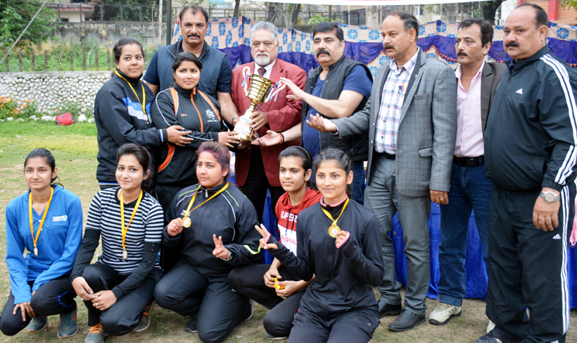 Winners of 6th J&K State Handball Championship posing for a group photograph along with chief guest Narinder Mahajan and other dignitaries in Jammu.
