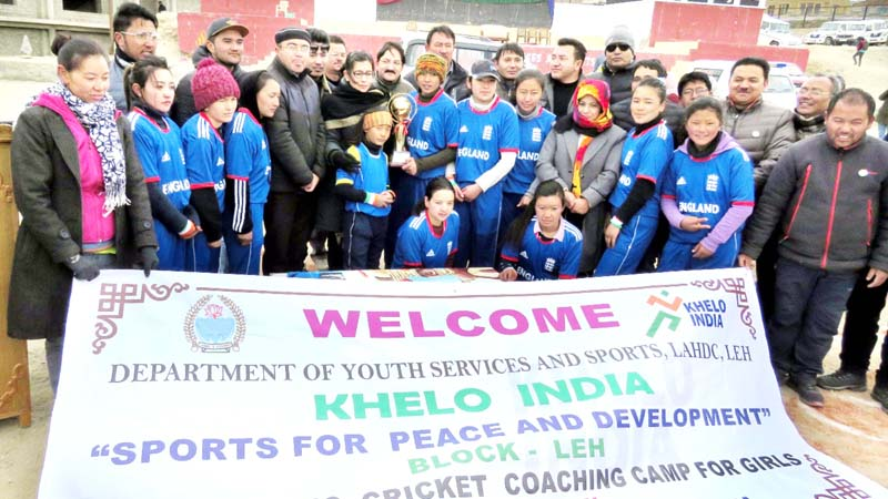 Young female cricketers posing for a group photograph during the concluding ceremony of basic cricket coaching camp at Leh.