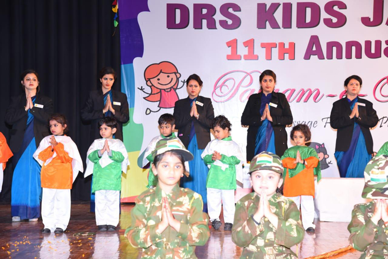Students in colourful attires during Annual Day celebration at General Zorawar Singh Auditorium.