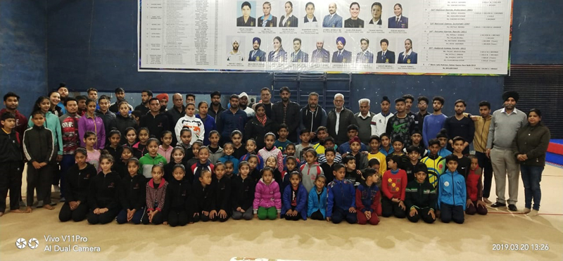 Young Gymnasts posing along with Secretary State Sports Council and other dignitaries in Jammu on Wednesday.