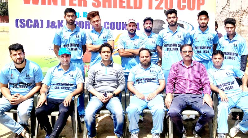 Media XI team posing for a group photograph along with officials in Jammu.