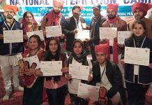 JU's NCC Volunteers displaying certificates after winning prizes in National Integration Camp.