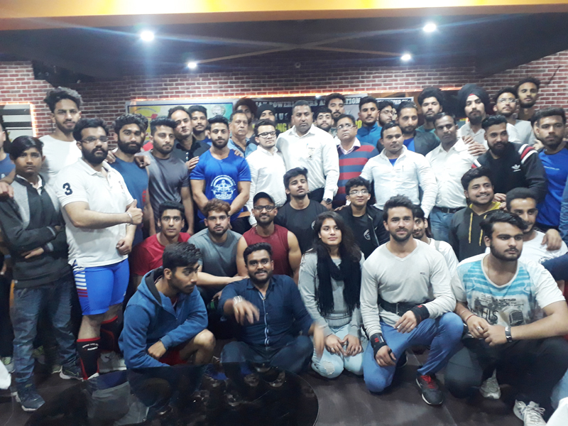 Powerlifters posing for a group photograph along with chief guest and other dignitaries in Jammu on Tuesday.