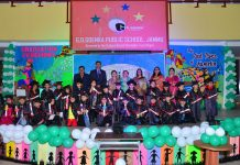 Children posing along with dignitaries during Annual Day celebration of GD Goenka (Kindergarten) in Jammu.