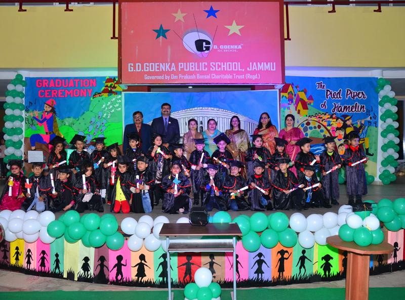 Children posing along with dignitaries during Annual Day celebration of GD Goenka (Kindergarten) in Jammu.
