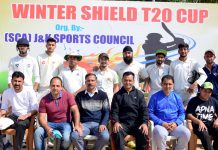 Vishal Cricket Club players posing for agroup photograph after scripting victory at Parade ground in Jammu.
