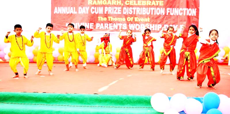 Students in colourful attires presenting a dance item during Annual Day Function at Kidzee Pre-School, Ramgarh in Samba.