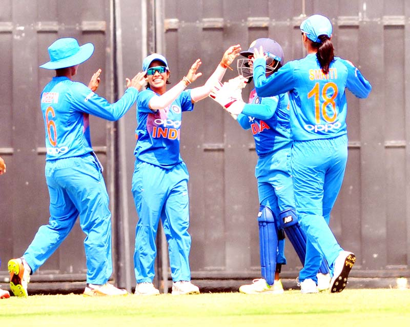 Indian players celebrating after dismissal of England's Tammy Beaumont during 3rd T20 match of womens cricket series against England at the Barsapara Cricket Stadium in Guwahati on Saturday. (UNI)