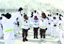 Northern Command Chief Lt Gen Ranbir Singh with troops at Siachen on Tuesday.