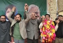 PDP vice president Abdul Rehman Veeri felicitating CPI (M) leader Mohd Amin Dar on joining PDP at a function on Sunday.