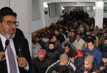 Altaf Bukhari addressing workers convention in Srinagar on Friday.