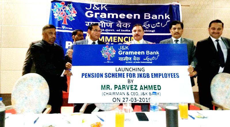 Chairman J&K Bank Parvez Ahmed and others launching pension scheme for employees of JKGB at Jammu on Wednesday.