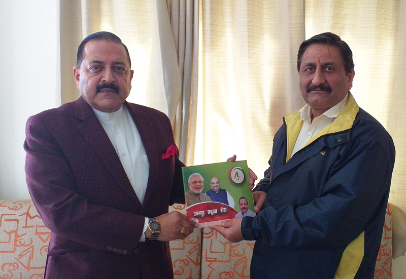 Union Minister, Dr Jitendra Singh handing over Table Book to Party spokesperson, Ashwani Chrungoo during media team meeting at Jammu on Wednesday.
