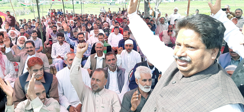 Senior Cong leader Raman Bhalla addressing election rally in Rajouri on Wednesday.
