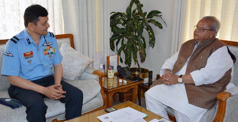 Governor Satya Pal Malik meeting Air Commodore Ajay Singh Pathania on Wednesday.